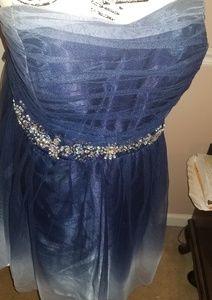 Strapless dress with rhinestones around waist.